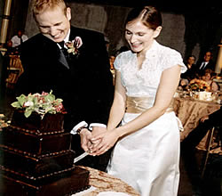 wedding couple cutting chocolate cake.